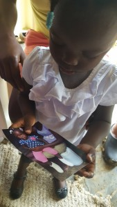 mission trip march 2017 little girl looking at her picture